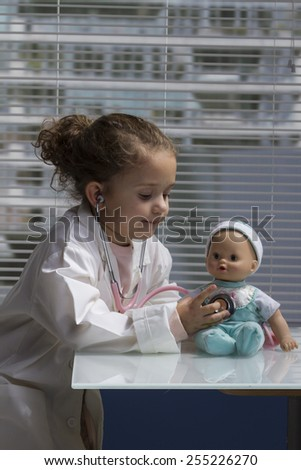 female child playing doctor