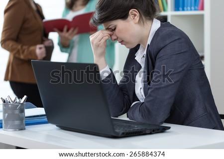 Female clerk having sinus pain at work - stock photo