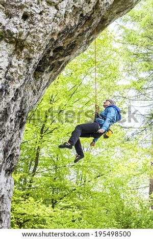 Female climber, woman climbing rock. - stock photo