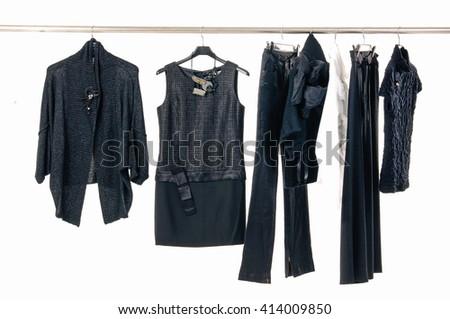 female clothes ,coat, jacket on Hangers - stock photo