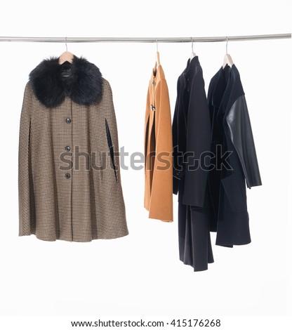 female,clothes ,coat rack display   - stock photo
