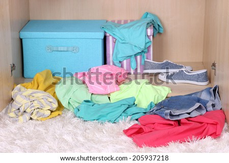 Female clothes lying on floor in room - stock photo