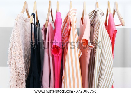 Female clothes on hangers, closeup - stock photo
