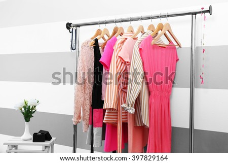 Female clothes on hangers in a room - stock photo