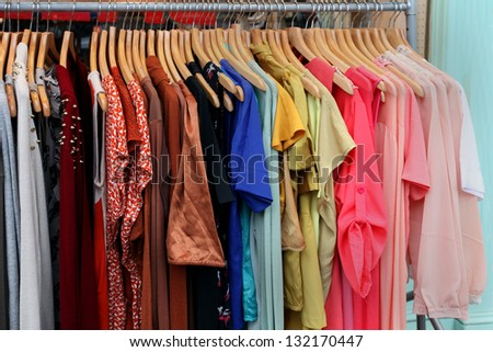 Female clothes on hangers in front of fashion store