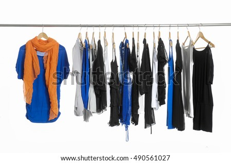 female clothes with scarf ,pants hanging on clothes rack