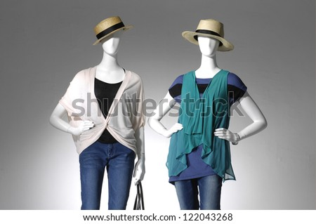 female clothing in jeans with bag on two mannequin - stock photo