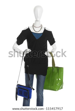 female clothing in jeans with green bag on mannequin