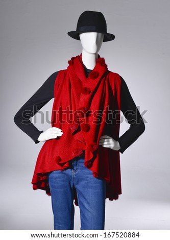female clothing in jeans with hat on mannequin in light background - stock photo