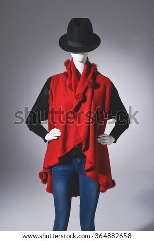 female clothing in jeans with hat on mannequin-light background - stock photo