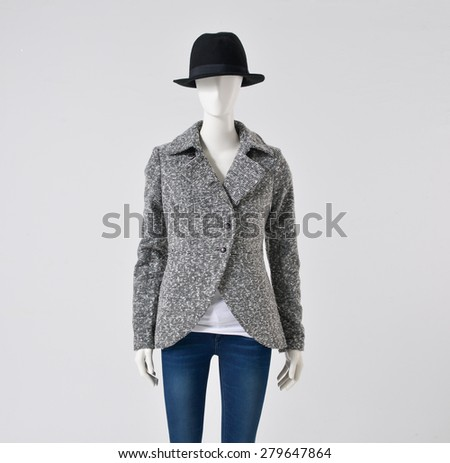 female clothing with jeans with hat on mannequin  - stock photo