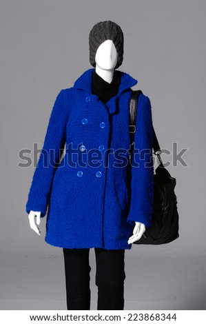 female clothing with winter coat with bag on mannequin-gray - stock photo
