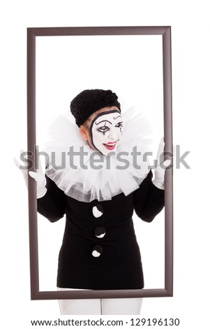 female clown in a frame is looking angry - stock photo