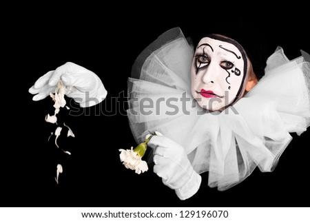 female clown is having lovesickness - stock photo