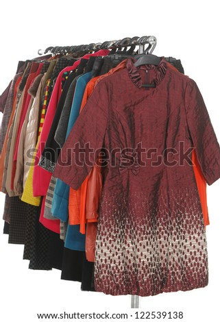 female coat clothes Variety of hanging on clothes rack