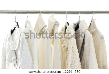 female coat on hangers at the show - stock photo