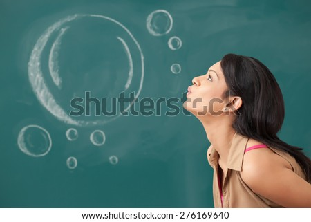 Female college student blowing - stock photo
