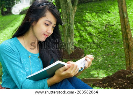 Female College student reading education books outdoor