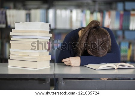 Female college student tired from studying - stock photo