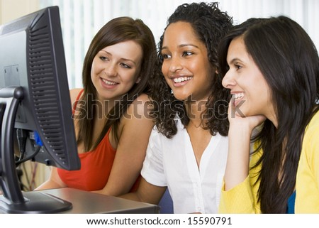 Female college students in a computer lab - stock photo