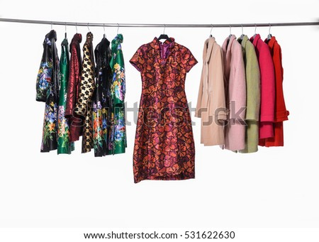 female colorful coat clothing ,sundress, chinese dress on hanger