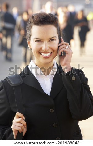 Female commuter talking on phone - stock photo