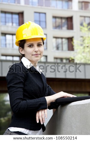 Female construction engineer and yellow helmet