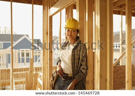 Female construction worker at construction site
