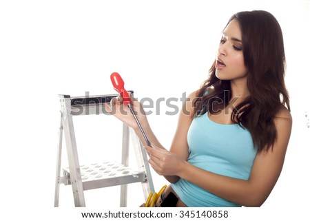 Female construction worker on a ladder over a white background. - stock photo