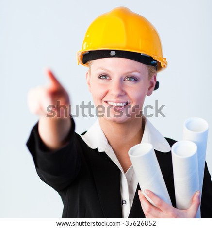 Female Construction worker pointing on a construction site