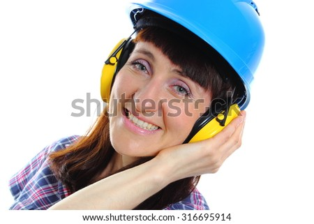 Female construction worker wearing blue helmet and protective headphones, safety at work and ear protection. White background