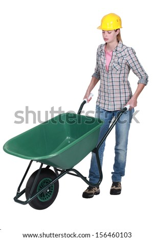 Female construction worker with a wheelbarrow