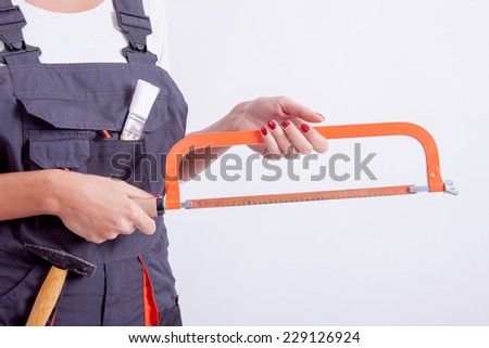 Female construction worker with tools on white background