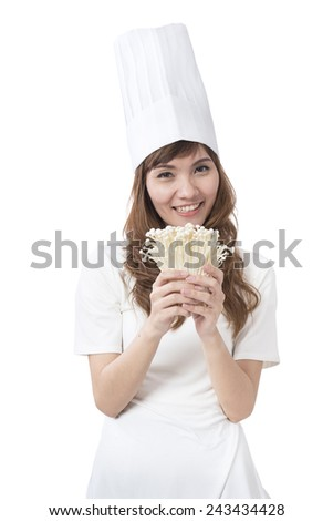female cook in white uniform with mushroom - stock photo