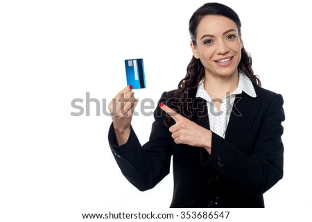 Female corporate executive displaying her credit card