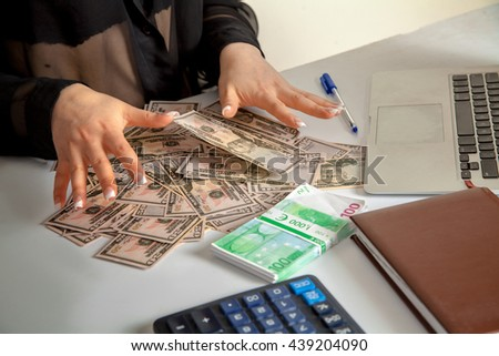 female counts a lot of money on the table. horizontal photo of a lot of money - stock photo