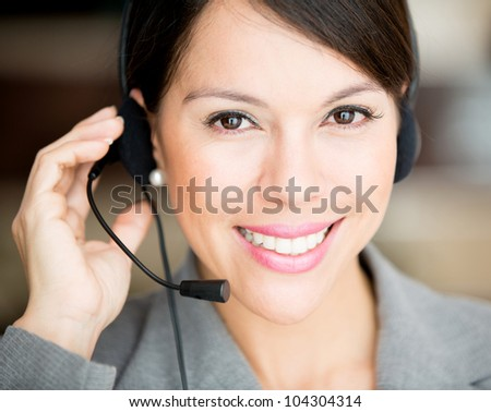 Female customer support operator with a headset - stock photo