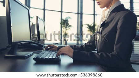 female customer support phone operator with headset at workplace