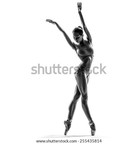 female dancer ballerina posing on white isolated studio background. high contrast black and white image - stock photo
