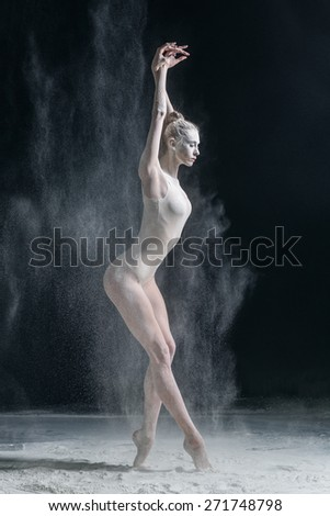 female dancer dirty in white flour  - stock photo
