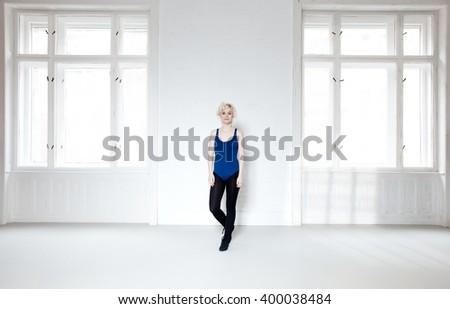 Female dancer standing in ballet studio. Full size. - stock photo