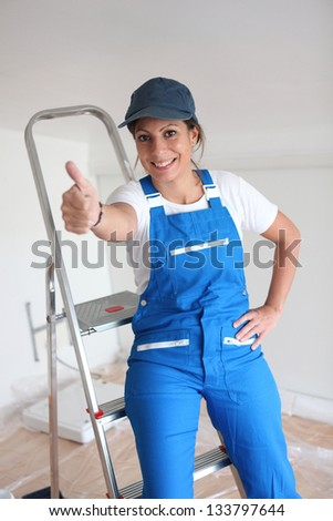 Female decorator happy with progress