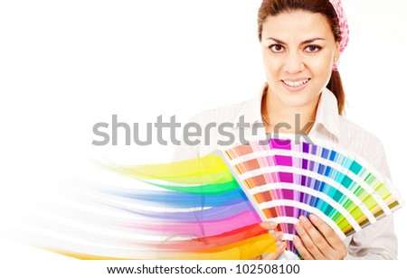 Female decorator holding a color guide and smiling - stock photo