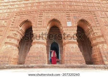 Female Devotee at Madanmohan Temple, Bishnupur , India - made of terracotta (baked clay) - world famous tourist spot. with MR - stock photo