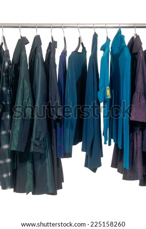 female different autumn clothing hanging on hangers