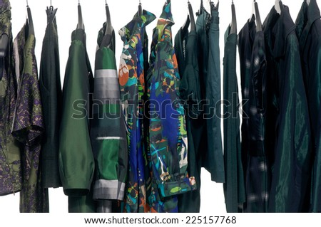 female different sundress clothes with jacket rack display  - stock photo