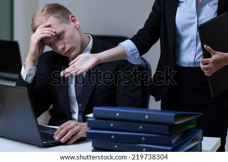 Female director criticizing employee's work - stock photo