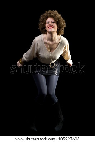 Female disco dancer smiling and having fun, shot on black background