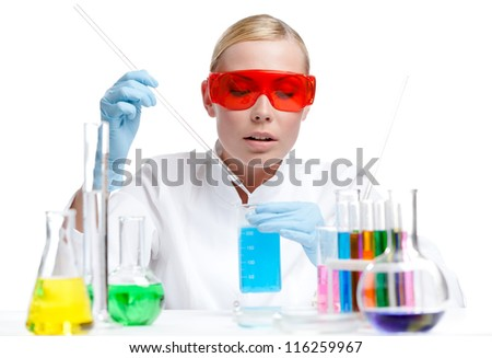 Female doctor analyzes some liquids, isolated on white