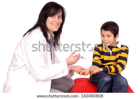 female doctor and boy with syringe - stock photo
